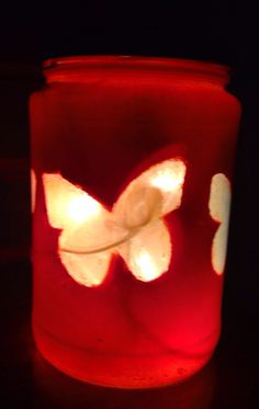 Check out more items at  https://www.etsy.com/listing/232652901/rainbow-butterflies-on-orange-jar #rainbow #butterfly #orange #lighted #bottle #lamp Visit lightitupcreations.com