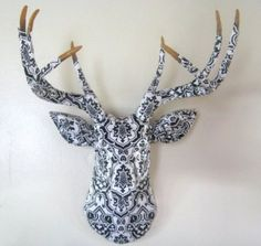 black and white wallpapered deer head