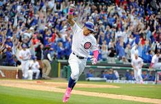 Walk-off winner:     Chicago Cubs third baseman Javier Baez hits a game-winning home run against the Washington Nationals during the 13th inning at Wrigley Field in Chicago on May 8. MLB teams wore pink in honor of Mother's Day. The Cubs win 4-3.