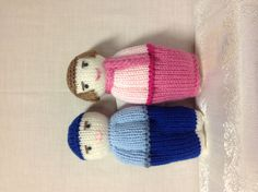 6 And 1/2 Inch Boy & Stuffed With Polyester Fiberfill, Hand-Knitted In Royal Blue Pants & Hat And A Light Blue Top.    6 And 1/2 Inch Girl Doll, Stuffed With Polyester Fiberfill, Hand-Knitted In A Hot Pink Skirt And A Pink Top