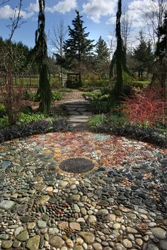 One of just two mosaics installed by Jeffrey Bale in the Eugene area is this installation at Northwest Garden Nursery, in the form of a seasonal wheel with colors and motifs relating to the four seasons.