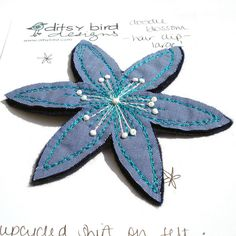 upcycled blue shirt hair clip    blossom hair clip made using my partner's upcycled work shirt, felt, freestyle machine embroidery and hand beading