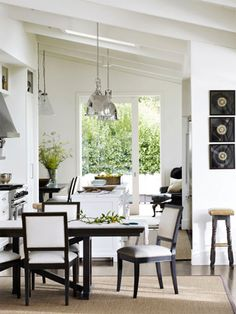 Use a white palette for your dining room furniture and decor to create an atmosphere that's both modern and classic.