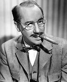 "Julius Henry ""Groucho"" Marx (October 2, 1890 – August 19, 1977) was an American comedian and film and television star.[1] He was known as a master of quick wit and widely considered one of the best comedians of the modern era.[2] His rapid-fire, often impromptu delivery of innuendo-laden patter earned him many admirers and imitators."