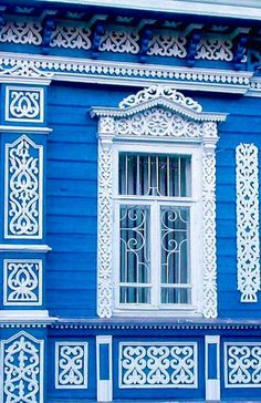 Russian wooden house with openwork carved decorations.