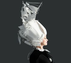 """""""Russian paper artist Asya Kozina has created a series of whimsical, hand-cut Baroque wigs whose plain white source material helps to highlight the insanity of their elaborate forms."""""""