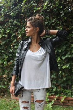 roughed up jeans, slouchy tee, and light leather jacket. hair up.
