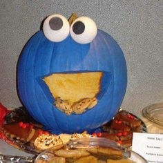 Pumpkin cookie monster...blue paint, ping pong balls and COOKIES!