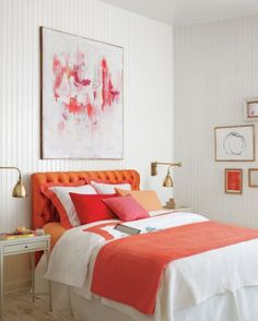A plain white bed is like a blank canvas. Color-block by adding two different solid-colored pillowcases, draping a throw across the bottom, and fitting the bed with a bright sheet. This orange headboard is store-bought, but you could also staple-gun colorful fabric around a headboard.