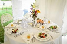 Naturally pretty wedding at Friendly Crossways Retreat Center in Harvard, MA with wildflower centerpieces