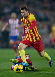 Lionel Messi (R) of FC Barcelona competes for the ball with Koke (L) of Atletico de Madrid during the La Liga match between Club Atletico de Madrid and FC Barcelona at Vicente Calderon Stadium on January 11, 2014 in Madrid, Spain.