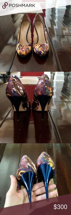 """HOST PICK 🤩 Silk Floral Giusseppe Zanotti 👠 STUNNING Giusseppe Zanotti heels made to perfection. Floral silk pattern will go with almost any dress. Features rounded toe with pleated silk toe cleavage, metallic blue heel, and stable 4""""stilettos. Runs 1/2 size small. I am a small 7(euro 37) and sized up to a 37.5.  Excellent used condition, worn once. Only sign of wear is scuffing on bottom of sole.  The silk/metallic heel like new.  If my feel didn't grow, these would still be in my closet…"""