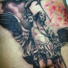 Guy's Tattoo Of Archangel Micheal