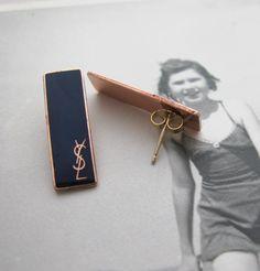 YSL Zipper Pull Earrings, Erica Weiner. $40