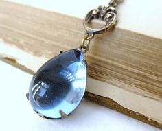 Vintage Rhinestone Necklace Sapphire Jewel Antiqued Brass Teardrop Estate Style. $24.50, via Etsy.