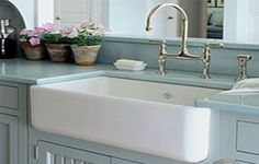 Apron front sink.. And I love the cabinet & countertop color!