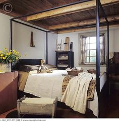 distressed cupboards for one side of bed..antique crock filled with flowers..Love