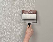 Wall & Paper applicator; patterned paint rollers take the place of expensive wallpaper. Genius!