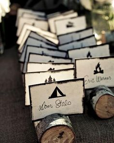 Seating cards displayed in small scored logs.