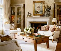 Simple Touches for Bold Contrast: Simple touches are sometimes all that is needed to add contrast and texture to your living room. Here, pillows covered in antique French fabrics stand out against cream upholstered pieces. Softly textured walls add a unique style and give the room an elegant appeal. Old-world cabinets and frames add to the timeless appeal.
