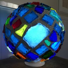 Chunk Glass Lamp - 14 inch diameter Sphere weighing about 35 pounds. This beautiful illuminated sculpture is hand made by California artist Troy Boepple. The glass chunks are individually cut from 12 inch by 8 inch by 1 inch thick slabs of glass also know as Dalle de Verre. The glass slabs used in these creations are from an art glass manufacturer that has been in business since 1898 and was one of the original suppliers for Tiffany's. Each of the glass chunks are hand chiseled.