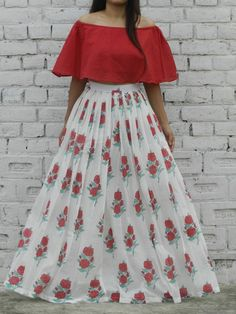 Red off shoulder cape top and rose hand block flared skirt set - strutting stylishly past the cafe. U overhear onlookers rave about that rockabilly Indian Skirt And Top, Long Skirt And Top, Tops For Long Skirts, Frock Design, Lehenga Designs, Long Dress Design, Long Skirt Top Designs, Off Shoulder Outfits, Indian Gowns Dresses