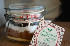 Layer hot cocoa ingredients in a glass jar for a pretty and easy favor or edible gift idea #partycrafters