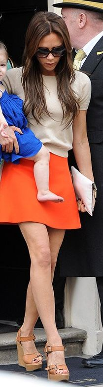 Victoria Beckham: Skirt and purse – Victoria Beckham Collection  Shoes – Chloe  sunglasses – Cutler and Gross
