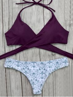 AD : Wrap Bikini Top and Baroque Bottoms - BURGUNDY This wrap bikini set is an essential for your vacation on the beach,wrap tie design creating an effectless fit,your will also love the retro inspired low waisted baroque print bottoms,pretty bathing suit you must have,padded. Swimwear Type: Bikini Bikini Type: Wrap Bikini Gender: For Women Material: Nylon,Polyester,Spandex Bra Style: Padded Waist: Low Waisted