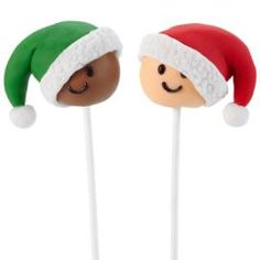 Holiday fun begins when Christmas cake pop pals are at the party! Topped with bright fondant hats, these pops are easy to make. Fun to serve, eat, and tuck into Christmas Eve stockings.
