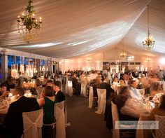 The reception was held in a blush and cream filled tent, which was bathed in a romantic glow from chandeliers overhead and tables covered in candlelight.