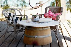 wine barrel table and mosaic tiled top.  Nice recycling. and great chairs. oh an great location...I could go on!