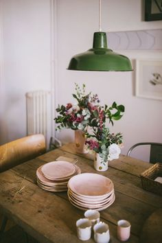 More blush pink & green. And great inspiration for how to step up the game of an inexpensive green metal hanging lamp. Plus a beautiful flower arrangement. xxoo - tads