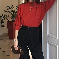 Red mock neck. Black trousers.