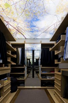 Cool wallpaper print on the ceiling in this Foz do Douro II House closet by José Carlos Cruz.