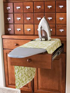 "Ok- this is a nice touch for a craft room. Very clever. - Jennifer ""Pam Porter suggested retrofitting a convenient and compact ironing board kit into a cabinet drawer. An electrical outlet was placed in the toe-kick of the cabinet below. My Sewing Room, Sewing Rooms, Space Crafts, Home Crafts, Sewing Room Organization, Pretty Room, Craft Storage, Fabric Storage, Homes"