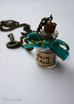 WIN: Bottle of Fairy Dust - Created the pendants tonight. Labelled them based on their colour.  Some were fairy dust, others were dreams.  I'm really happy with the results.  Not sure if they should be ornaments or necklaces yet...