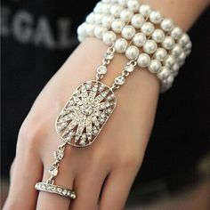 DESCRIPTION_ This is a very nice replica of Daisys bracelets in Great Gatsby and this is perfect for your vintage themed wedding or Gatsby party!  It is decorated with lots of sparkling rhinestones and faux pearls, on a stretch bracelet to fit all sizes.The ring fits M and L size (recommend) but if you have S size you can wear it as well because the bracelet helps to fit it to your finger.  If you want a adjustable ring please convo me before place the order.  Great Gatsby matching headband…