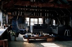 barn style living room complete with an egg hanging chair - industrial chic    SICK SICK SICK