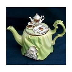Royal Albert China - Collector Teapots, Green Tablecloth Revealing White Underneath, Lide is Cup, Saucer, & Teapot w Magazine.