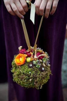 This little moss ball on a ribbon is so sweet! Try gluing flowers, gems, shells or other little tidbits to make it interesting and festive (via Two Ring Studios)