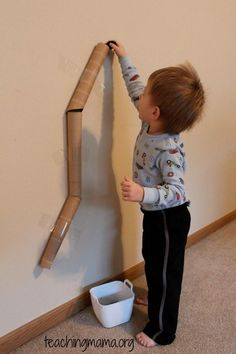 This will keep the kids entertained for hours.  Make a tunnel with empty paper towel rolls taped to the wall.