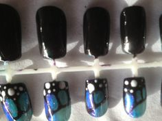 Beautiful butterfly shellac manicured stick on false fake nails by Sarah Orman at SO Health and Beauty. These are Blue, Purple, Green, Black and white polka dots with sparkle additives and glitter using CND Shellac products. Call Sarah on 07429977674 www.sohealthandbeauty.co.uk