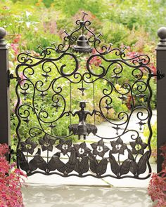 Garden gate made of forged iron with a black-brown finish. Includes latch and hinges. Has an outward opening with the closure latch on the gate's right side. Application of a sealant coating is recomm