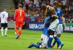 Germany 1 Italy 2, Italy striker Mario Balotelli is mobbed by his team-mates after scoring a double (Euro 2012)