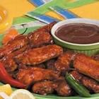 Wing Sauce - Serves 10 - 3 pounds whole chicken wings 2 cups ketchup 1/2 cup honey 2 tablespoons lemon juice 2 tablespoons vegetable oil 2 tablespoons soy sauce 2 tablespoons Worcestershire sauce 1 tablespoon paprika 4 garlic cloves, minced 1 1/2 teaspoons curry powder 1/2 teaspoon pepper 1/8 teaspoon hot pepper sauce 1 teaspoon cayenne pepper Squirt of BBQ Sauce