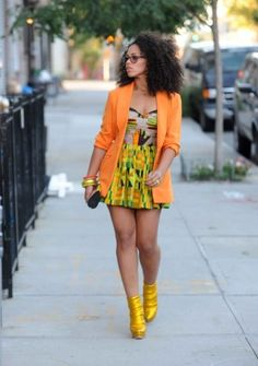 Not everyone can wear orange. Elle is fly. Those glasses. And that hair! All yes everything.