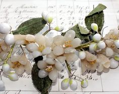 """Close up of Antique French Wax Orange Blossom Wedding Tiara with sweet flowers and wax dipped buds. Since Victorian times, Orange Blossoms were worn as a Bride's Head Crown as symbols of happiness and fertility ~ because the orange tree blooms and bears fruit at the same time. ca early 1900's.     This Bridal Headpiece or Tiara has a multitude of Wax Buds on Silkwrapped Wire. The headpiece measures about 7"""" x 8"""" x 2~1/2"""" high, it still has the original elastic"""