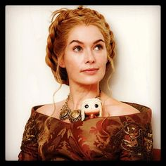 Lena Headly of Game of Thrones posing with her Funko POP counterpart Ceresi Lannister.