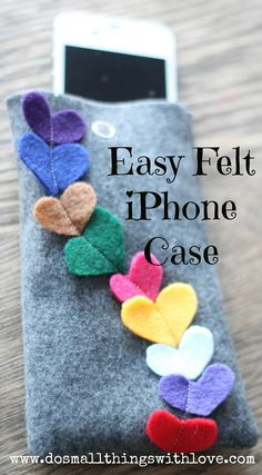 So, since we all have one, here is a SUPER EASY case for an iphone to whip up for your Valentine.  It can be completed in 10 minutes or less, seriously!    Let's get started!  Supplies: Felt scarps, Stick Pins, Snap, Sewing Machine and Thread.    1. Cut two rectangles of felt, one centimeter larger on all sides than your iphone.  Then cut out several little hearts, roughly the same size in various colors of felt.